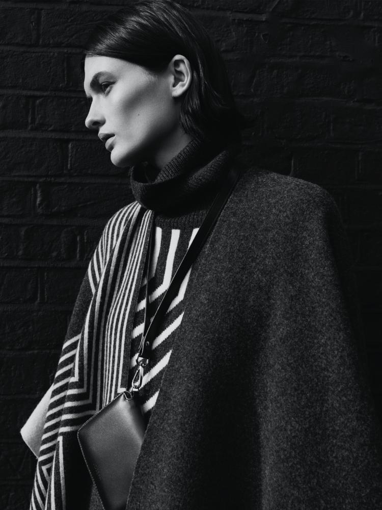 Model wearing Kaftan Wool Poncho and Cozumel Light Strap Zip Wallet