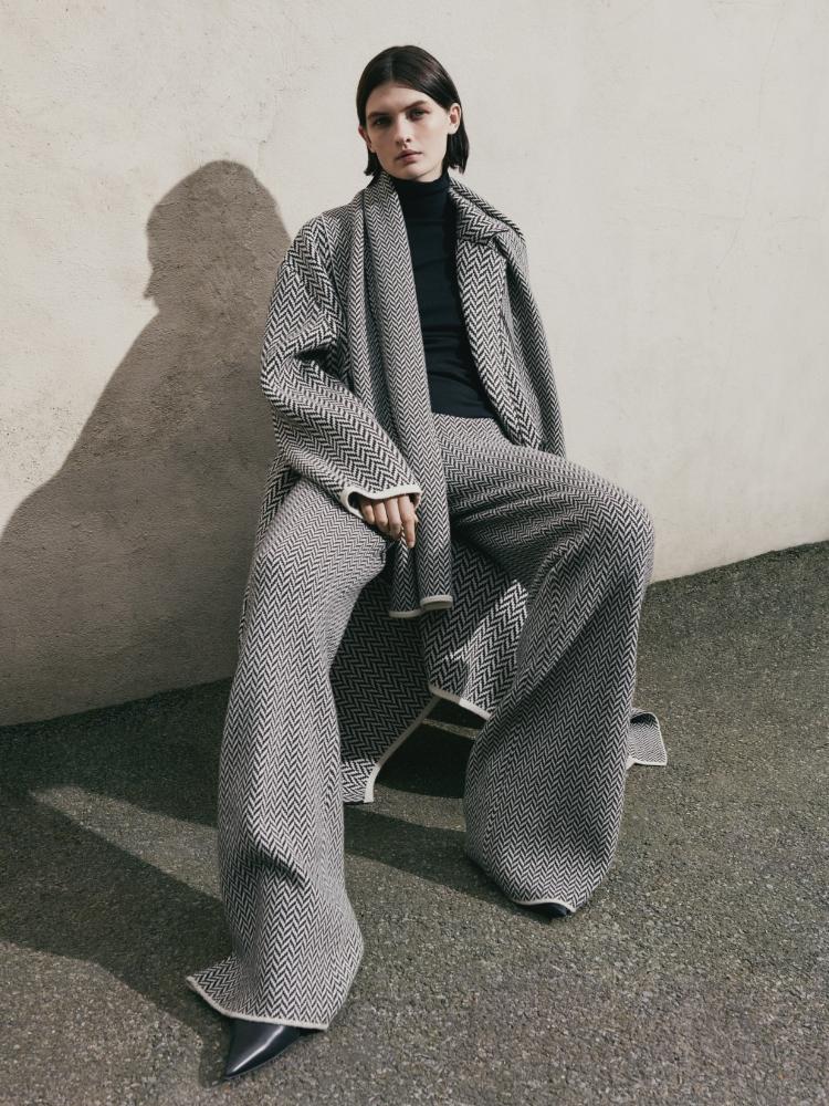 Model wearing Herringbone Coat and Herringbone Trousers